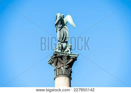 Sculpture Of An Angel With 4 Lions On A Pillar - Jubilaumssaule Pillar On Schlossplatz Square In Fro