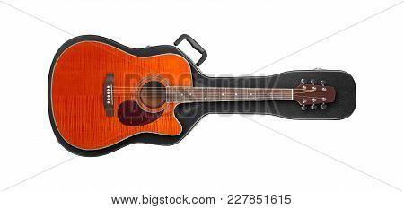 Musical Instrument - Orange Cutaway Guitar From Above On A Hard Case On A White Background.