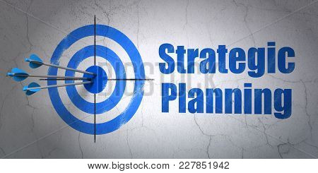 Success Business Concept: Arrows Hitting The Center Of Target, Blue Strategic Planning On Wall Backg