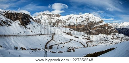 Snowy Pyrenees Mountains With A Small Winding Road