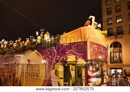 Festival Of Lights Parade The Gift Of Disney Vacations Bus With Pluto Dressed As Santa Clause, Chica