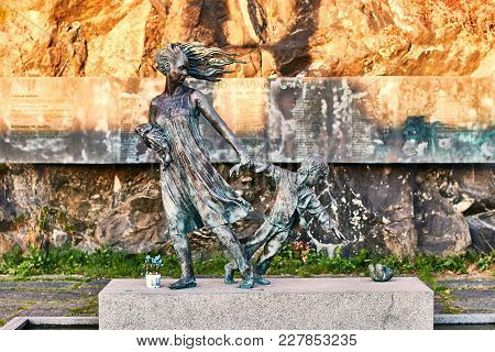 Oslo, Norway: Apr 25 2017 - Sculpture Of Mother Pulling The Boy Away From The Disaster. The Memorial