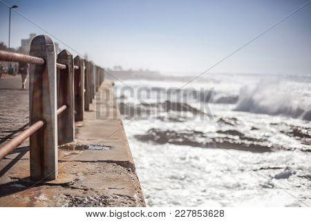 Handrail Going Of Into Distance Along Seafront In South Africa.