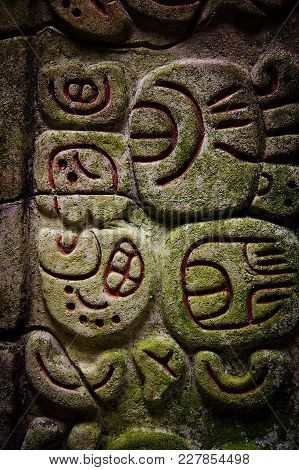 Ancient Mayan Hieroglyphics In Stone From The Ruins At Caracol, Belize