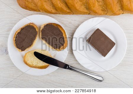 Sandwiches With Chocolate Butter In Plate, Butter In Plate, Loaf Of Bread, Knife On Wooden Table. To
