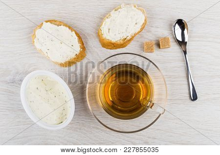 Sandwiches With Curd Cheese With Greens, Curd Cheese In Box, Sugar, Tea In Cup, Spoon On Wooden Tabl
