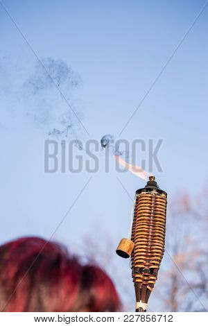 Pernik, Bulgaria - January 26, 2018: Custom Made Wooden Torch Hold And Carried Burning By A Kuker An