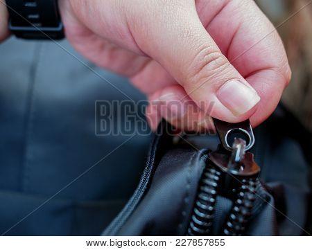 Hand Holding Bag Zipper Close Up Hand Opening Bag