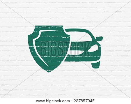 Insurance Concept: Painted Green Car And Shield Icon On White Brick Wall Background