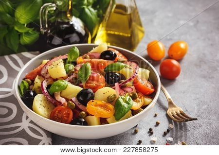 Potato Salad With Tomatoes, Olives, Capers, Red Onion, Italian Style Cuisine. Insalata Pantesca.