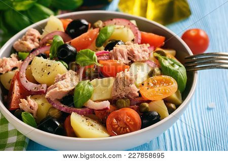 Potato Salad With Tuna, Olives, Capers, Tomatoes And Red Onion.