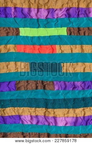 Textile Background - Stitched Patchwork Scarf From Many Narrow Silk Bands