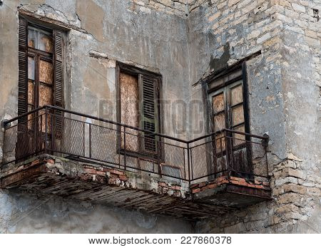 Damaged Old Vintage House  Balconies Ready To Collapse