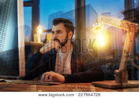 Rather Interesting. Smart Experienced Worker Of A Big Company Sitting With His Hand Touching The Chi