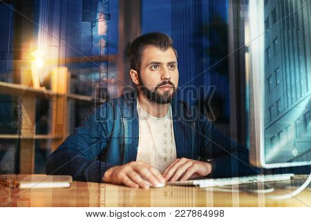 Important Information. Calm Attentive Responsible Employee Sitting In His Comfortable Office Alone A