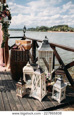 Wedding Ceremony On The River With Candle Lamps