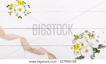 A Bouquet Of White Flowers Cosmea Or Cosmos With Ribbon On White Boards. Garden Yellow Flowers Over