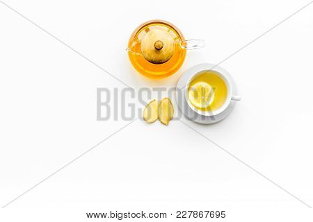 Warming Tea With Lemon And Ginger. Cup, Teapot, Ginger Root On White Background Top View.