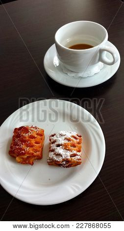 Coffee Break. White Cup With A Little Coffee And A White Plate With Two Cookies.