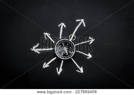 Direction Of Movement, Travel Direction. Compass Among The Arrows On Black Background Top View.