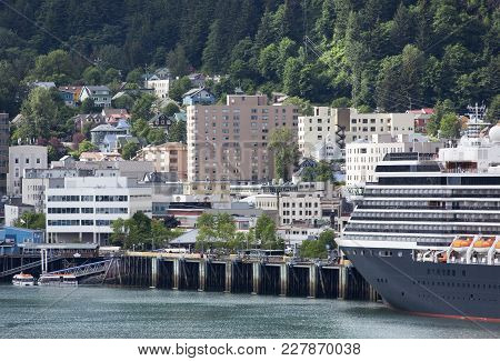 The Cruise Liner Moored In Juneau Downtown, The Capital Of Alaska.