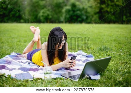 Young Woman Working On Laptop In The Outdoor