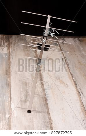 Yagi Uda Antenna For Uhf Tv Isolated On The Wooden Background