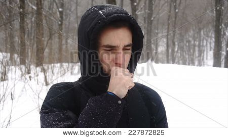 Caucasian Man Smelling Stinky Crinkle Face On White Snow Background.