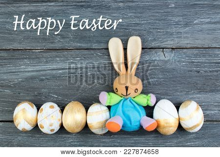 Happy Easter. Colorful Easter Eggs And Rabbit On Wooden Background