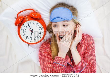 Shocked Young Woman Being Late Wearing Cute Pink Pajamas Holding Big Red Old Fashioned Clock Showing