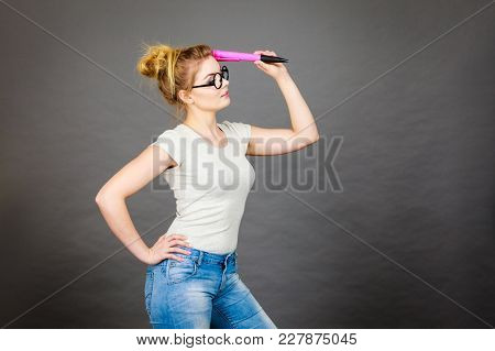 Student Looking Woman Wearing Nerdy Eyeglasses Holding Big Oversized Pencil Thinking About Something
