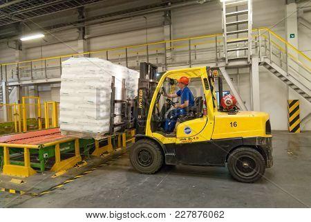 Tobolsk, Russia - July 15. 2016: Sibur Company. Polymer Plant. Driver On Forklift Truck Loads Pallet