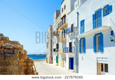 Monopoli, Italy - July 21, 2006: View Of The Houses Of The Seafront