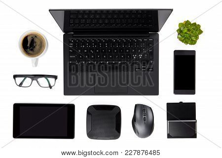 Overhead View Of Various Devices Arranged With Coffee Cup, Plant And Eyeglasses On Isolated White Ba