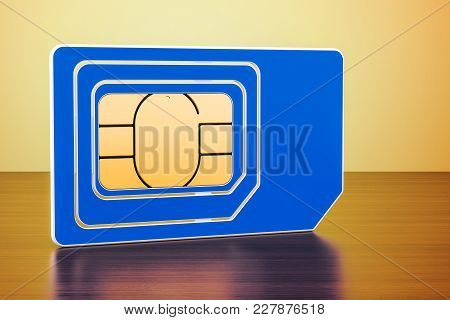 Sim Card On The Wooden Table. 3d Rendering