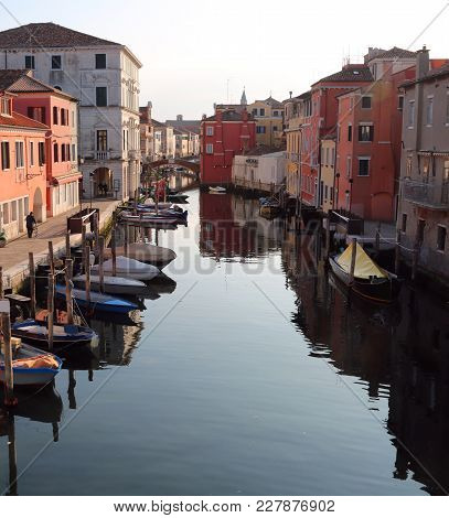 Wide Canal With Boats In Chioggia Island Near Venice In Italy