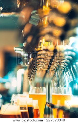The Beer Taps In A Pub. Nobody. Selective Focus. Alcohol Concept. Vintage Style. Beer Craft. Bar Tab