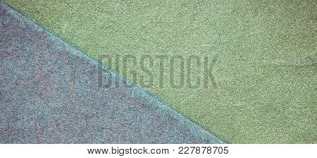 Blue And Green Playground Or Sports Ground Rubber Crumb Cover Grunge Background.