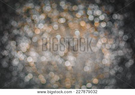 Abstract Background With White Bokeh On Gray Background. Christmas Blurred Beautiful Shiny Christmas