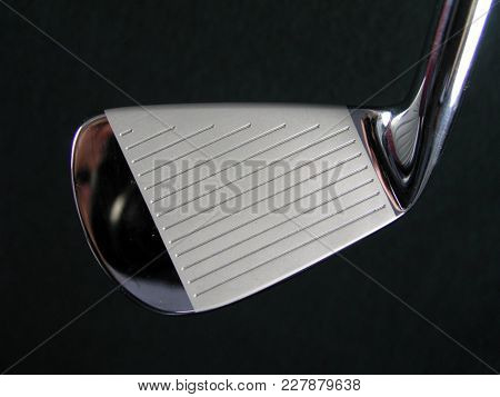 Generic Clean Shiny Polished Golf Club Iron Head Closeup Image On Dark Background