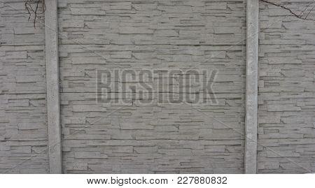 Stone Fence. The Masonry Of Thin Stone Slabs. Grey Texture