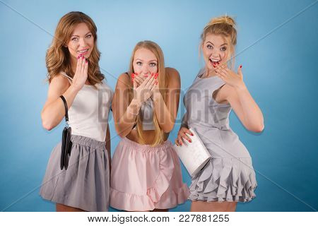 Shocked Young Elegant Women Holding Purse Wallet Ready For Shopping Or Party, Seeing Sales.