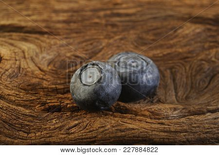 Blueberry Fresh Fruit At On Wooden Background