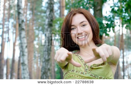 Girl pointing at camera at the park