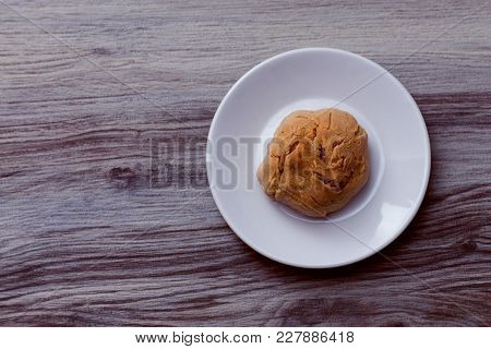 A Cookie With Cracks On A White Plate