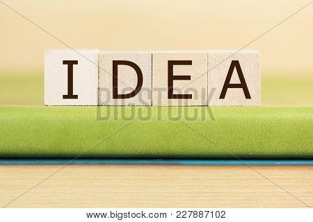 Idea Written In Wooden Cubes On A Green Book