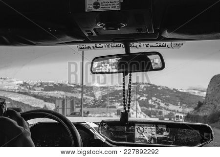 Jericho, Israel - August 06, 2010: Black And White Picture From The Cockpit Of A Taxi On The Road To