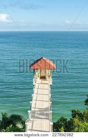 Samana - Dominican Republic. Samana Bay And Hanging Over A Cliff Elevator. Vivid Ocean Water And Blu