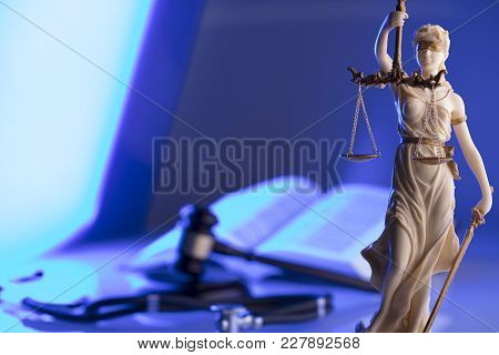 Medical Law Concept. Statue Of Justice, Gavel And Stethoscope, Blue Light. Place Fort Text.