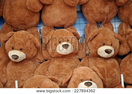 Teddy Bear Stuffed Animals On A Wall As Prizes At A Carnival